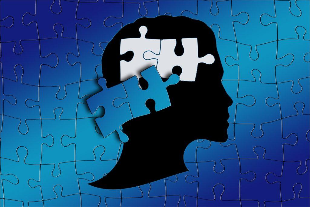изображение головы из пазлов, аутизм у детей